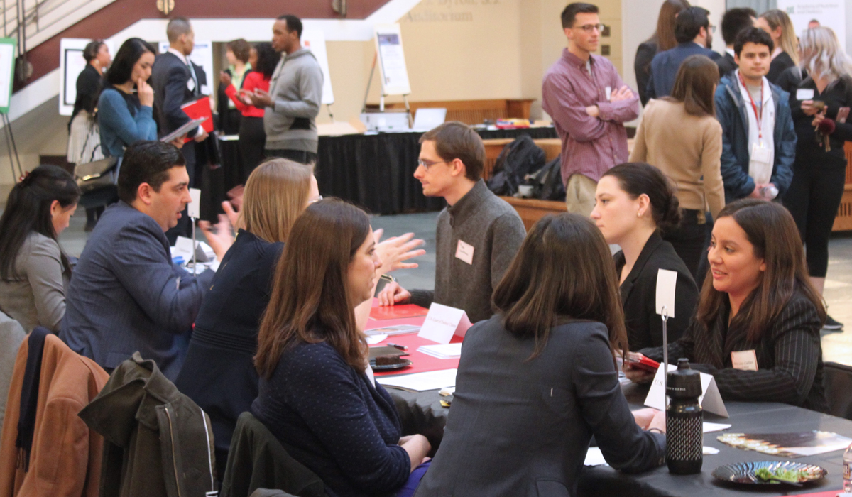 students at a job fair in the law school atrium