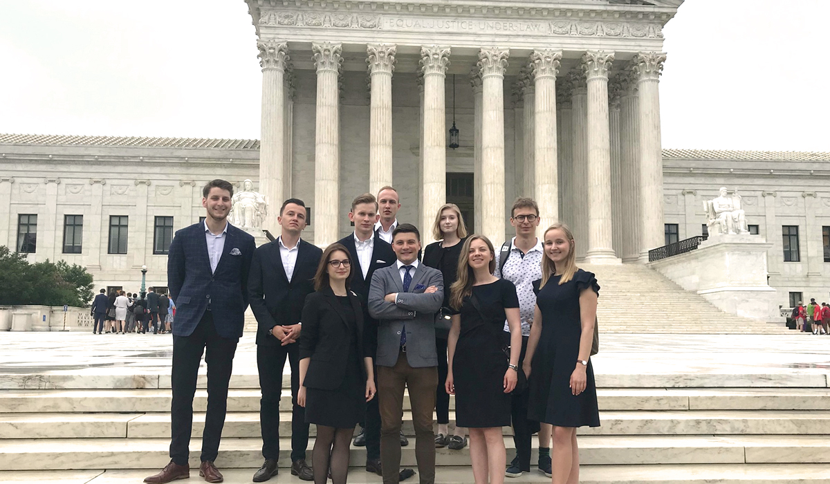 students standing in front of the Supreme Court
