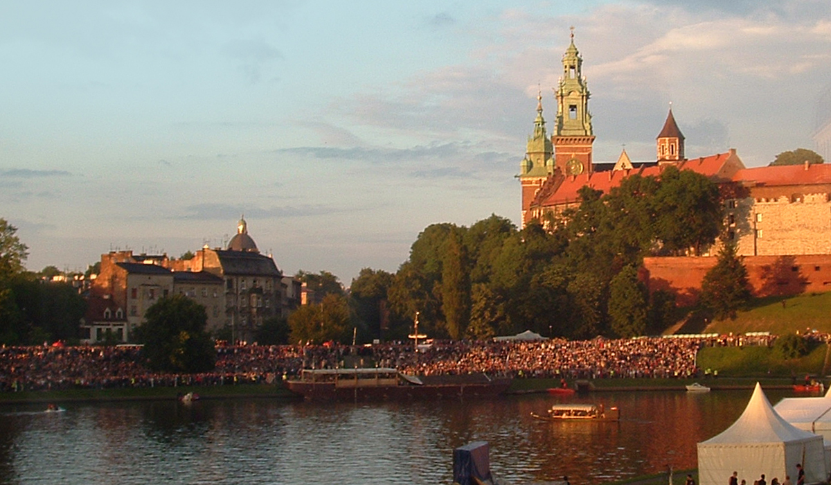 scenic photo of lake and buildings in Cracow, Poland