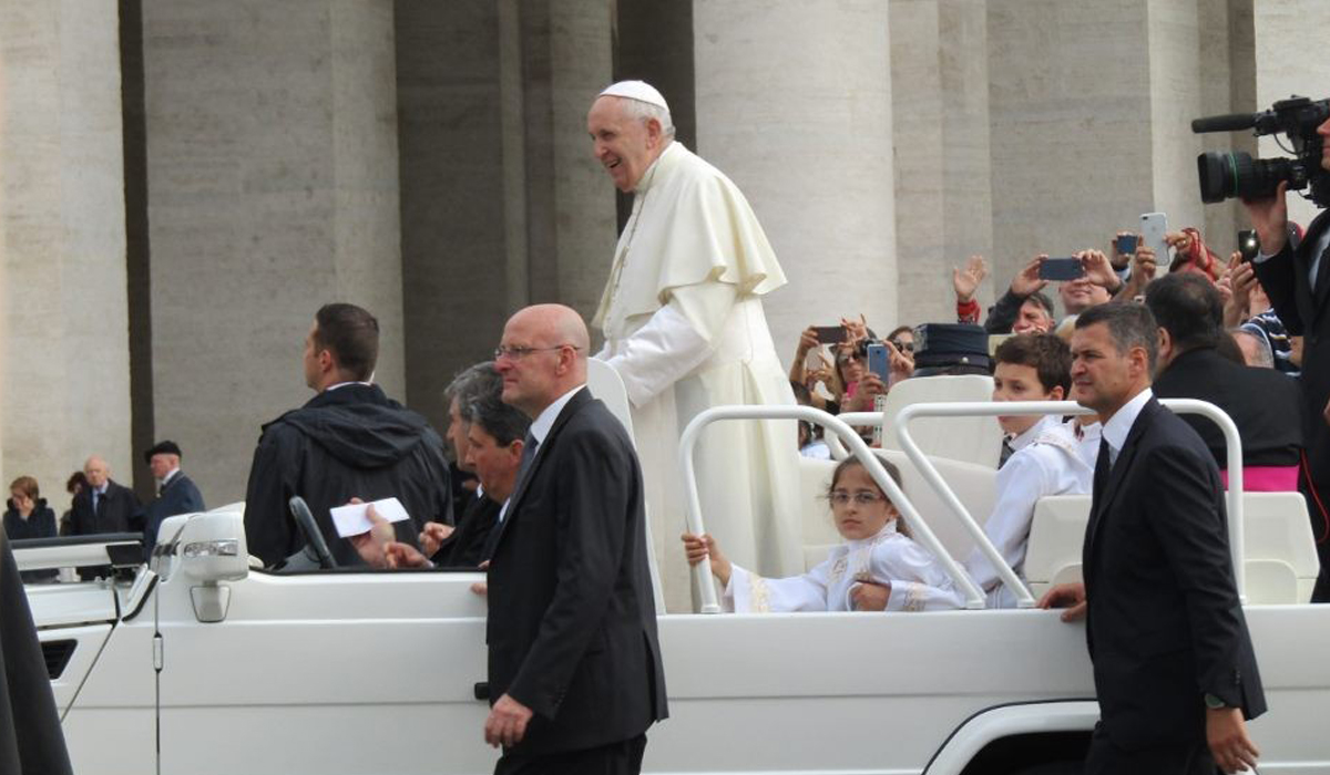 pope Francis in a car