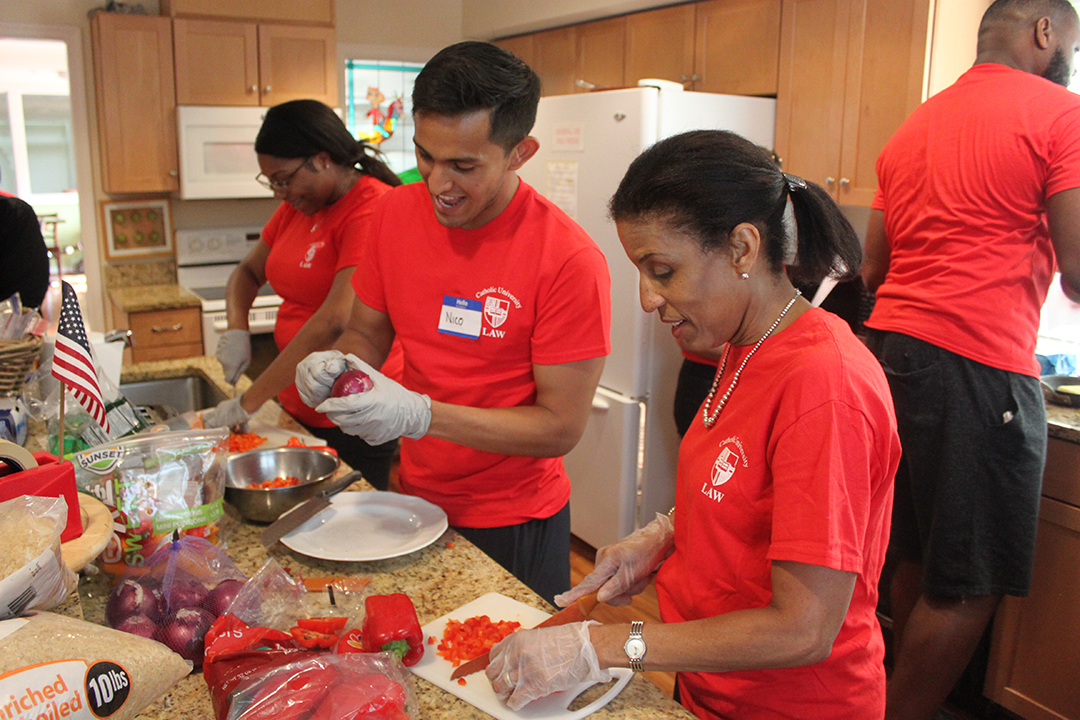 Students and faculty volunteering in kitchen